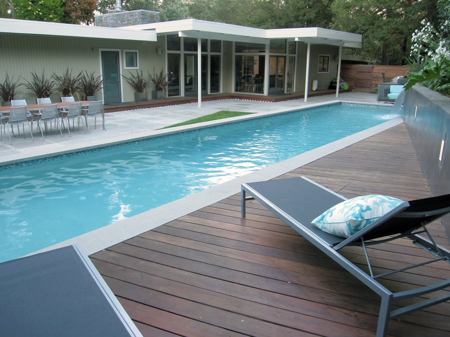What are the benefits of using brick pavers for your swimming pool deck?